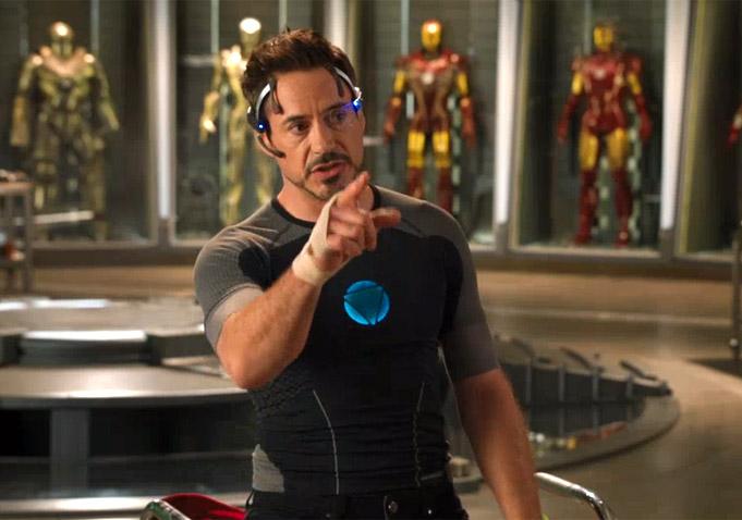 Robert Downey Jr as Tony Stark who is Iron Man in Iron Man 3 where Tony Stark is talking about Iron Man in Iron Man 3.