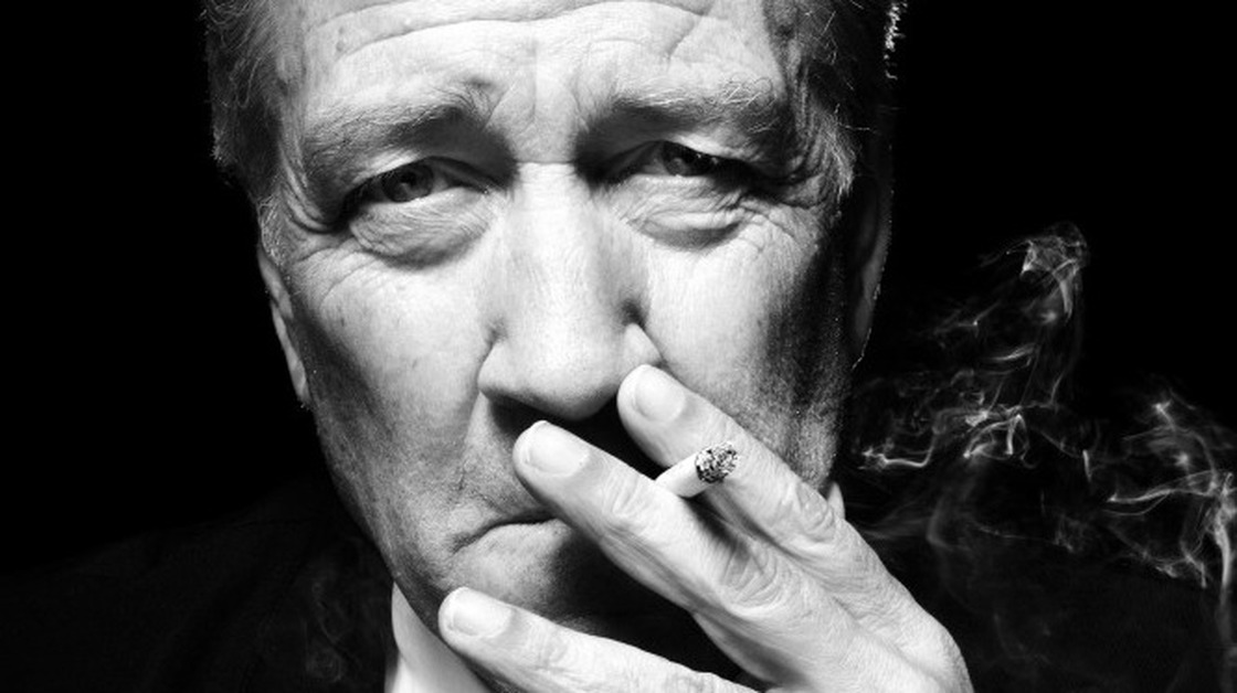 David Lynch smoking a cigarette (or weed)