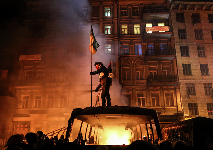 "At the beginning of ""Winter on Fire: Ukraine's Fight For Freedom,"" we see the streets of Kiev, Ukraine filled with peaceful demonstrations against the ..."