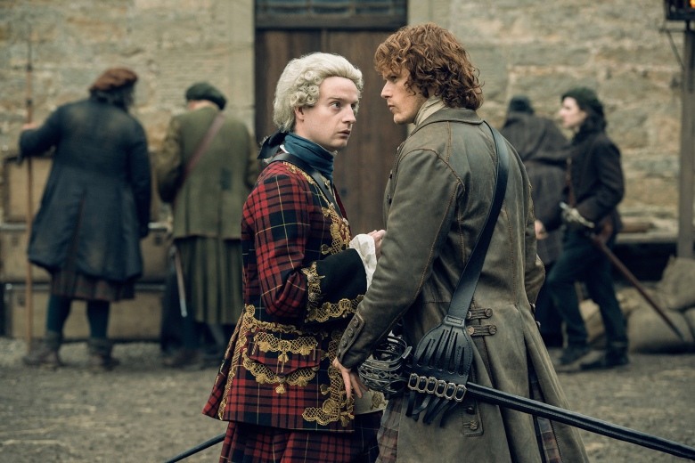 "Andrew Gower and Sam Heughan in ""Outlander."""