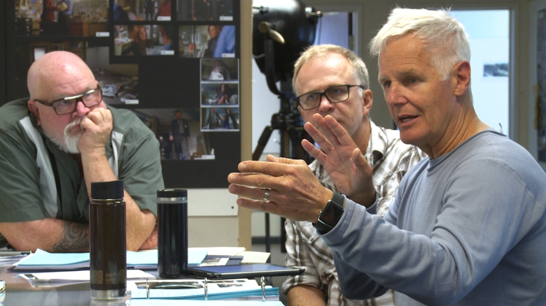 "Chris Carter (R) during a production meeting for ""The X-Files."""