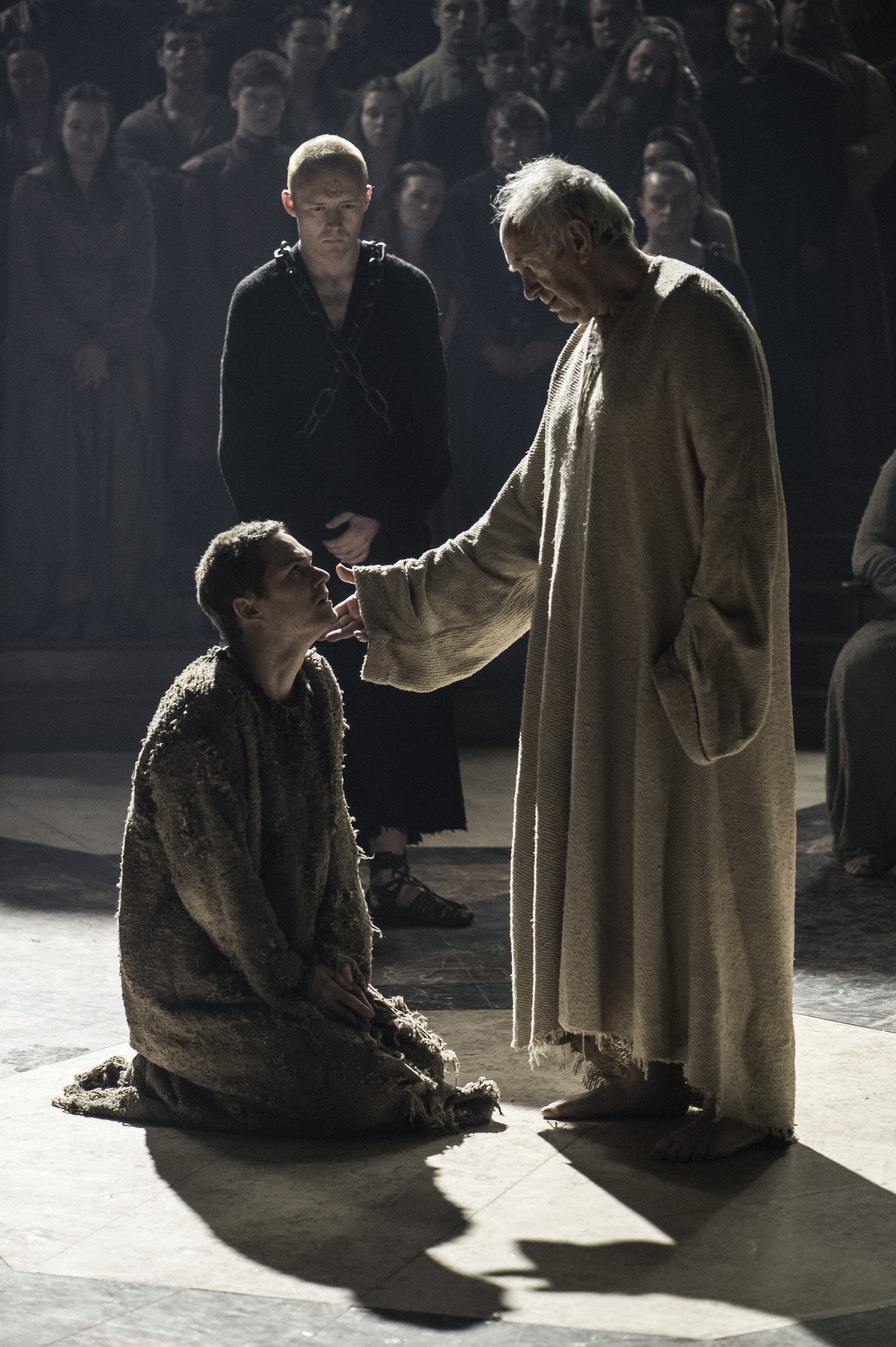 Finn Jones as Loras Tyrell and Jonathan Pryce as the High Sparrow in Game of Thrones