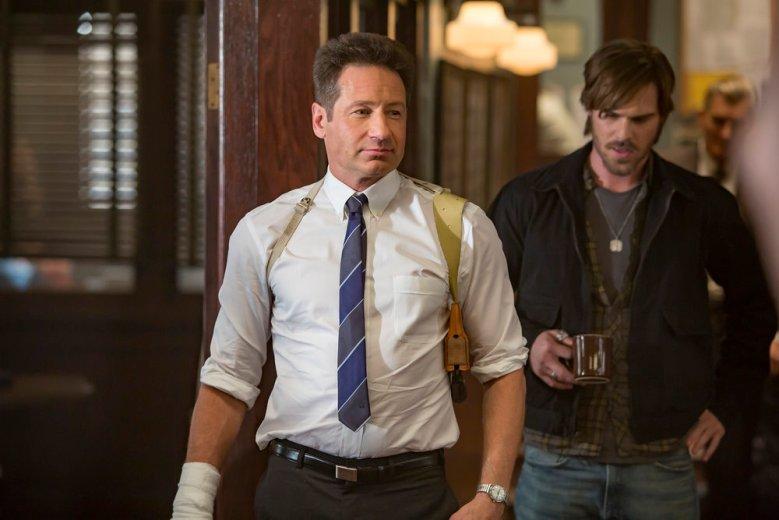 "AQUARIUS -- ""Happiness is a Warm Gun"" Episode 202 -- Pictured: (l-r) David Duchovny as Sam Hodiak, Grey Damon as Brian Shafe -- (Photo by: Ron Batzdorff/NBC)"