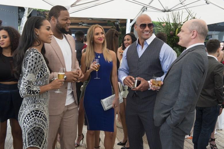 "Brooklyn Sudano, Ndamukong Suh, Arielle Kebbel, Dwayne Johnson, Rob Corddry in ""Ballers."""