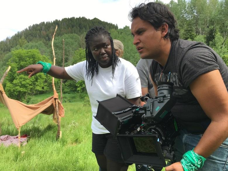 """Directing Fellow Frances Bodomo and DP Pedro Gomez Millan on the """"Afronauts"""" set."""