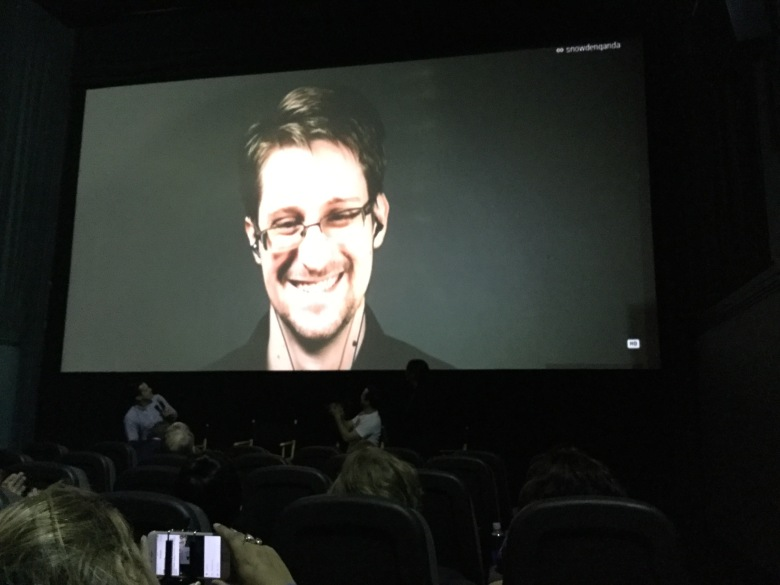 """Edward Snowden appears at a Comic-Con screening of """"Snowden,"""" via Google Hangout."""