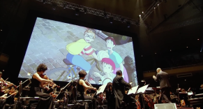Joe Hisaishi conducting a live concert of Studio Ghibli's greatest scores