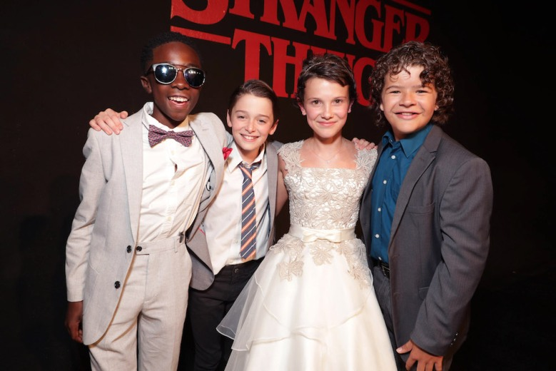 "Caleb McLaughlin, Noah Schnapp, Millie Brown, Gaten Matarazzo seen at the red carpet premiere in support of the launch of the Netflix original series ""Stranger Things"" at Mack Sennett Studios on Monday, July 11, 2016, in Los Angeles, CA. (Photo by Eric Charbonneau/Invision for Netflix/AP Images)"