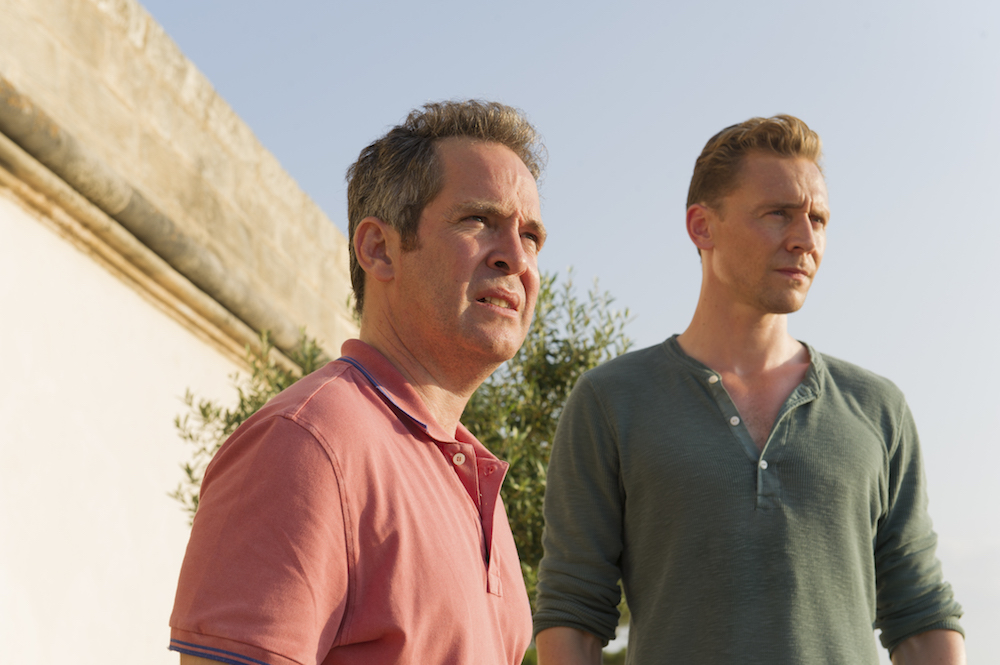 Tom Hiddleston as Jonathan Pine; Tom Hollander as Major Lance Corcoran; group - The Night Manager _ Season 1, Episode 3 - Photo Credit: Des Willie /The Ink Factory/AMC
