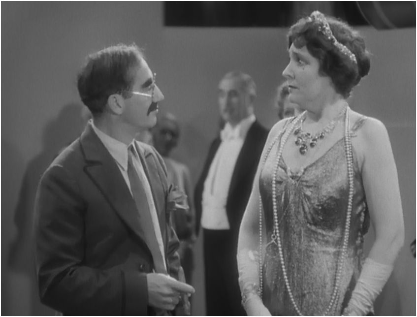 Groucho Marx and Margaret Dumont.