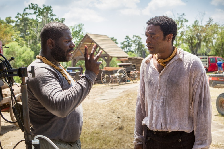 "Steve McQueen and Chiwetel Ejiofor during the filming of ""12 Years A Slave."""