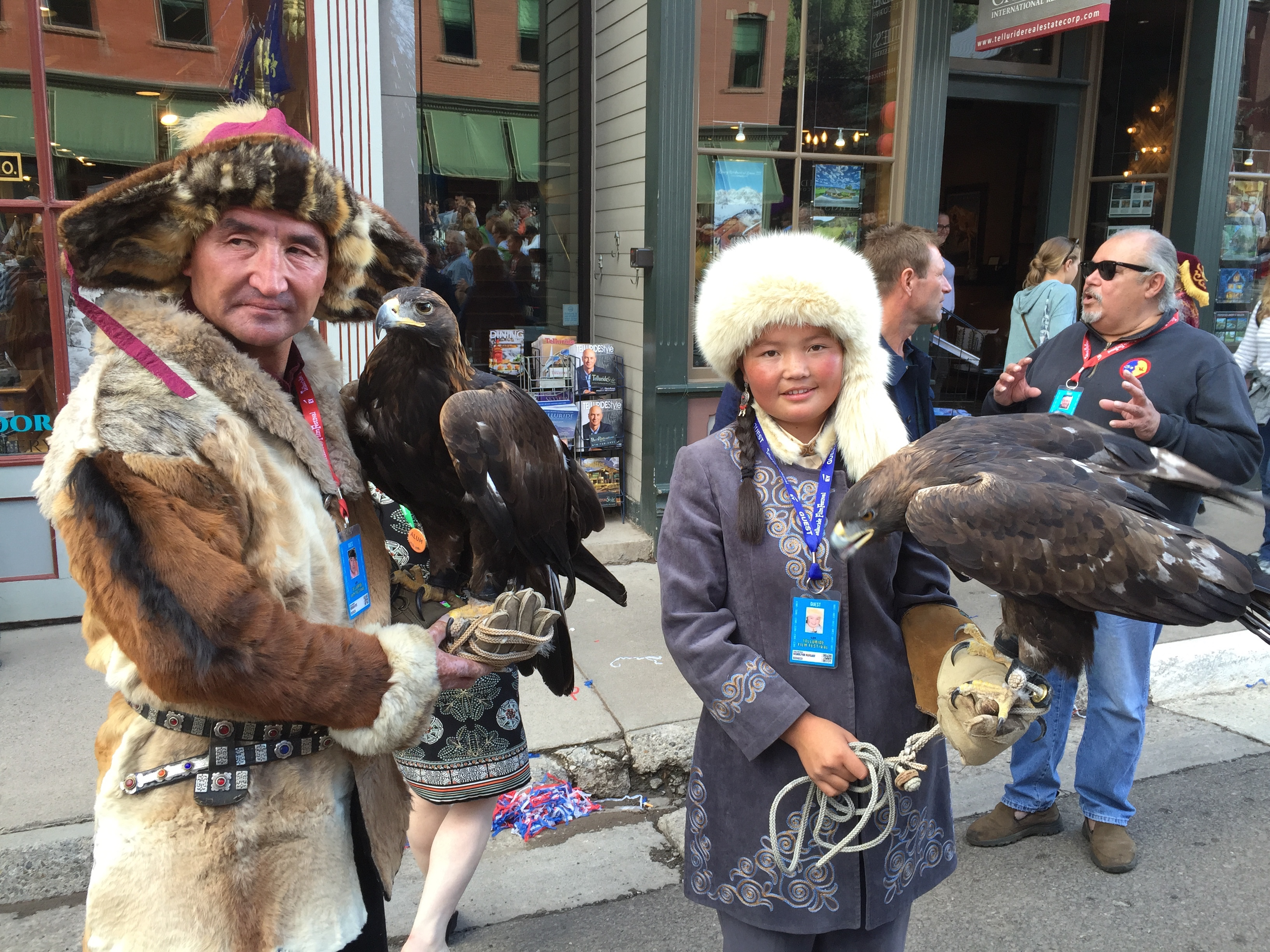 """The Eagle Huntress"" father and daughter with their hunters."