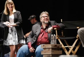 NEW YORK, NY - OCTOBER 08: Moderator Laura Prudom and creator and executive producer Guillermo del Toro speak onstage as Netflix presents Dreamworks Trollhunters during New York Comic Con at Madison Square Garden on October 8, 2016 in New York City.