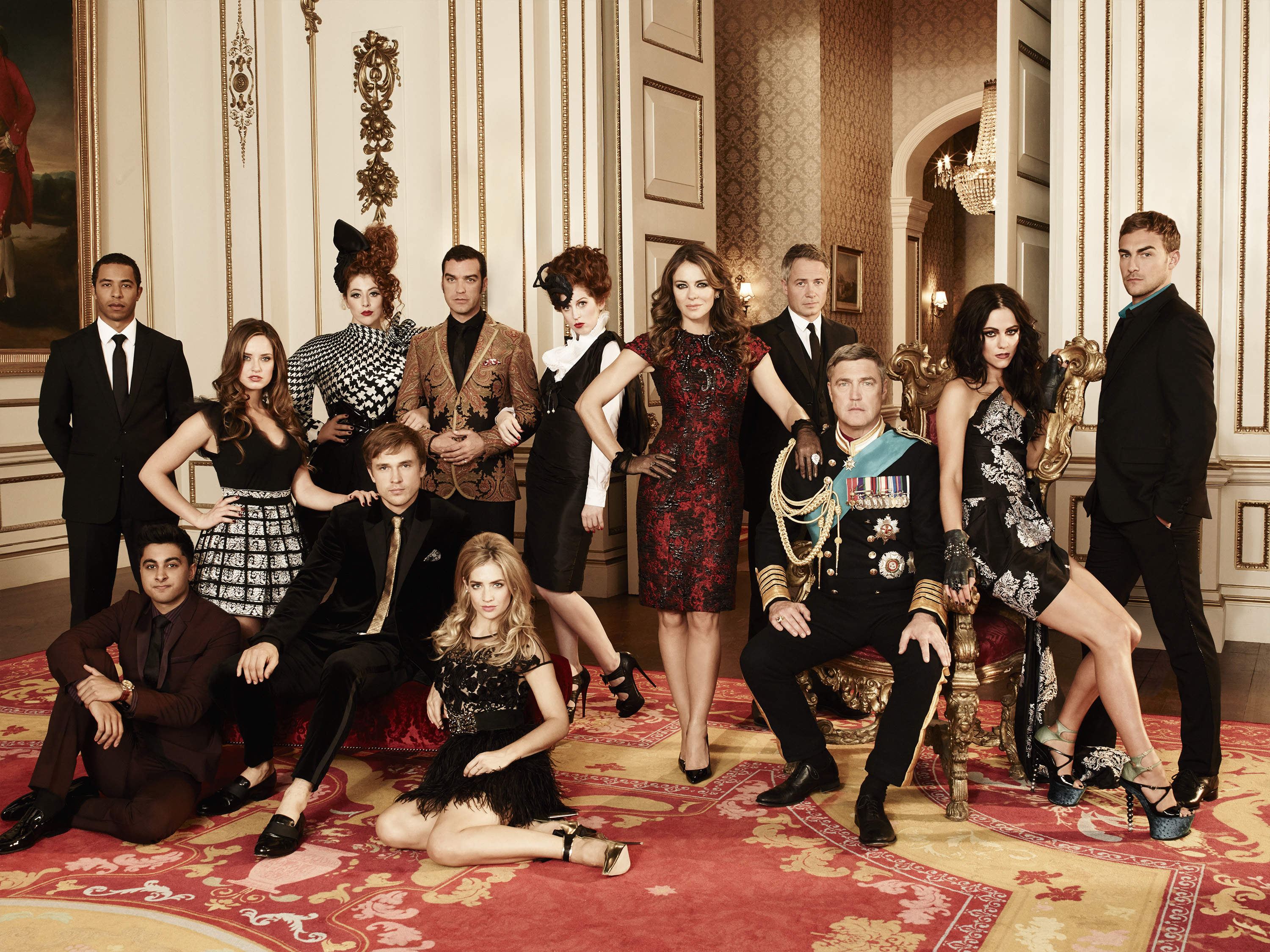 THE ROYALS -- Season: 1 -- Pictured: (l-r) Manpreet Bachu as Ashok, Ukweli Roach as Marcus, Merritt Patterson as Ophelia, William Moseley as Prince Liam, Lydia Rose Bewley as Penelope, Jake Maskall as Cyrus, Sophie Colquhoun as Gemma, Hatty Preston as Maribel, Elizabeth Hurley as Queen Helena, Oliver Milburn as Ted, Vincent Regan as King Simon, Alexandra Park as Princess Eleanor, Tom Austen as Jasper -- (Photo by Frank W. Ockenfels 3/E! Entertainment)