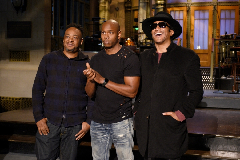 """SATURDAY NIGHT LIVE -- """"Dave Chappelle"""" Episode 1710 -- Pictured: (l-r) Jarobi White and Q-Tip of musical guest A Tribe Called Quest pose with host Dave Chappelle (center) on November 10, 2016 -- (Photo by: Rosalind O'Connor/NBC)"""