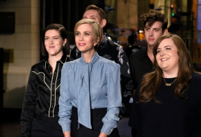 "SATURDAY NIGHT LIVE -- ""Kristen Wiig"" Episode 1711 -- Pictured: (l-r) Romy Madley Croft, Oliver Sim, and Jamie xx of musical guest The xx pose with host Kristen Wiig and Aidy Bryant on November 17, 2016 -- (Photo by: Rosalind O'Connor/NBC)"