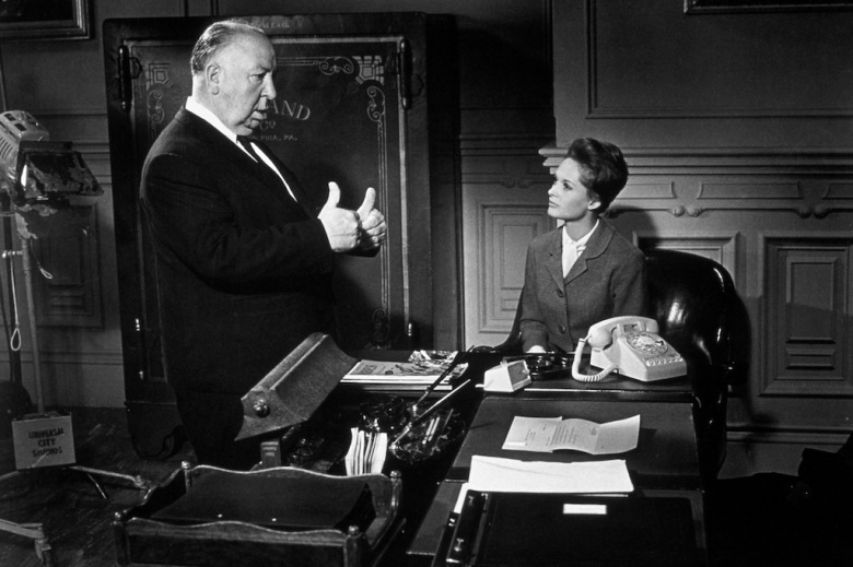 "Alfred Hitchcock and Tippi Hedren on the set of ""Marnie"""