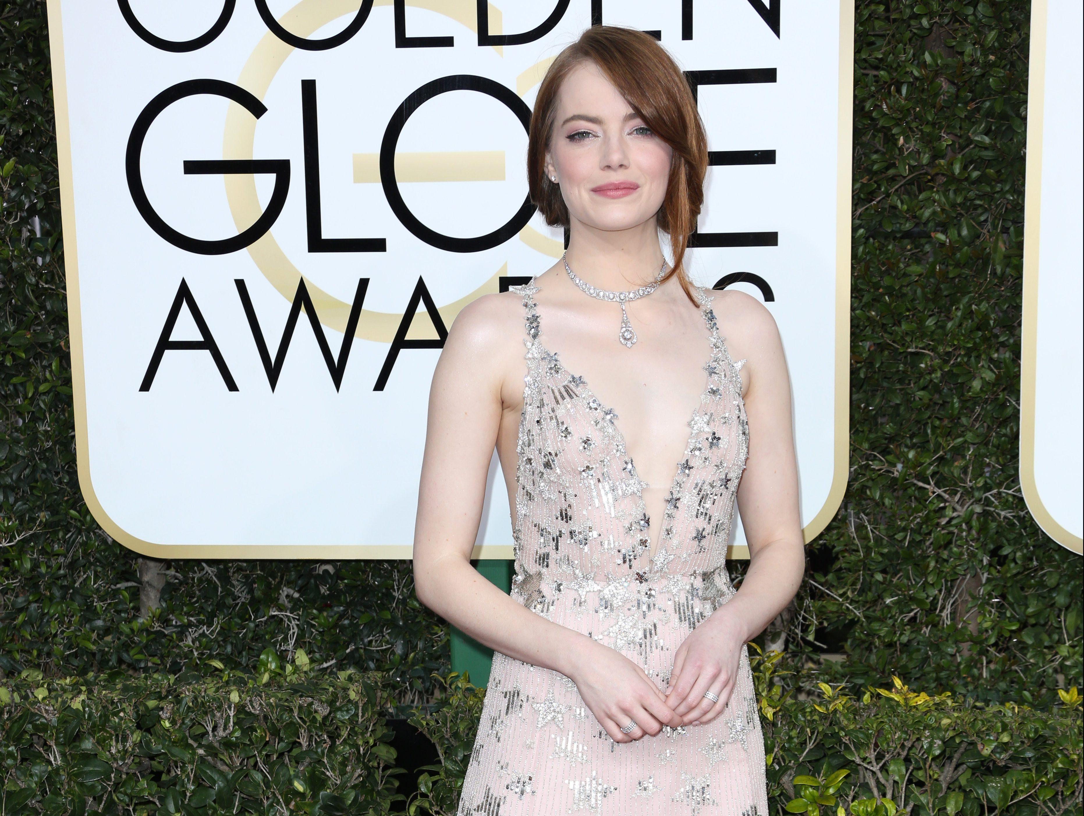 Oscar Race For Best Actress Is Emma Stone vs. Isabelle ...  Emma Stone Golden Globes