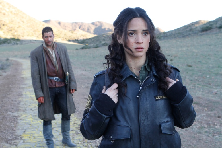 "EMERALD CITY -- ""Prison of the Abject"" Episode 102 -- Pictured: (l-r) Oliver Jackson Cohen as Lucas, Adria Arjona as Dorothy -- (Photo by: Rico Torres/NBC)"