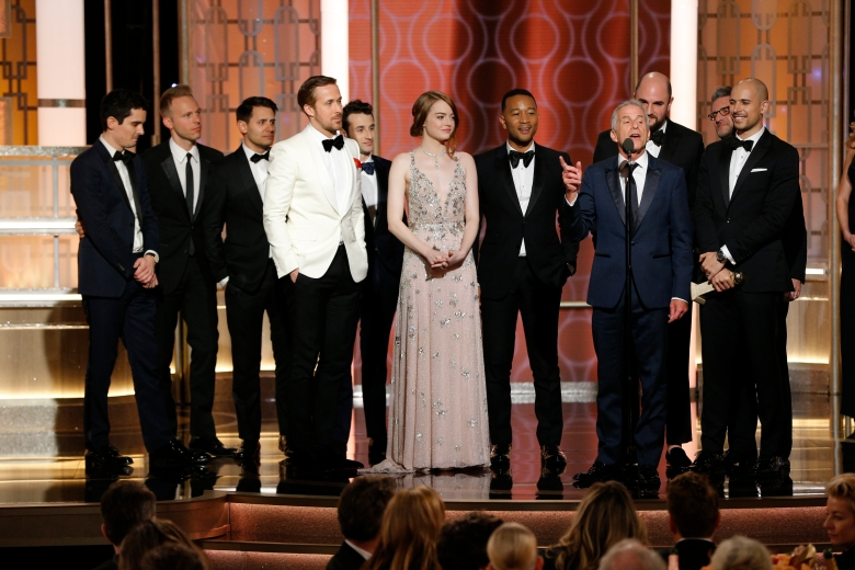 """74th ANNUAL GOLDEN GLOBE AWARDS -- Pictured: (l-r) Jordan Horowitz, Fred Berger, Producers, """"La La Land"""", accepting the award for Best Motion Picture - Musical or Comedy, at the 74th Annual Golden Globe Awards held at the Beverly Hilton Hotel on January 8, 2017 -- (Photo by: Paul Drinkwater/NBC)"""