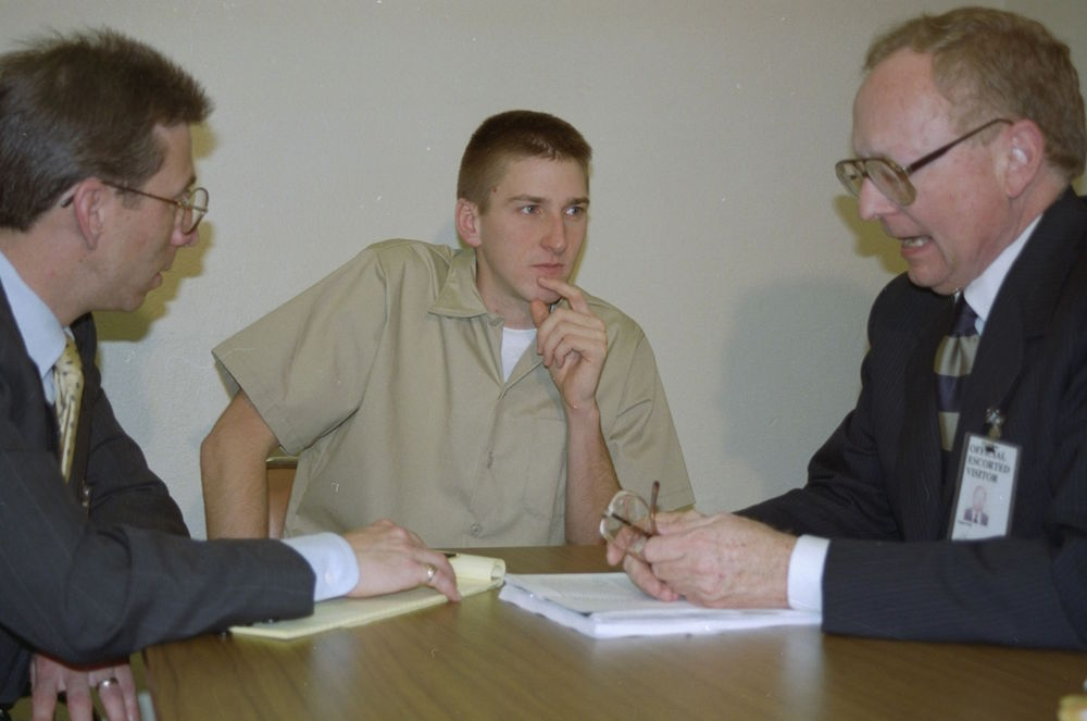 Oklahoma City bombing suspect Timothy McVeigh, center, confers with attorneys Stephen Jones, right, and Robert Nigh, at the federal prison in El Reno, Oklahoma