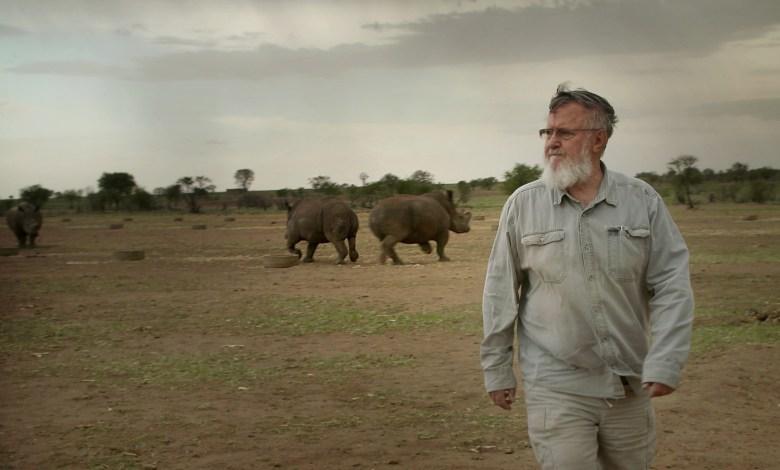 John Hume with his rhinos.