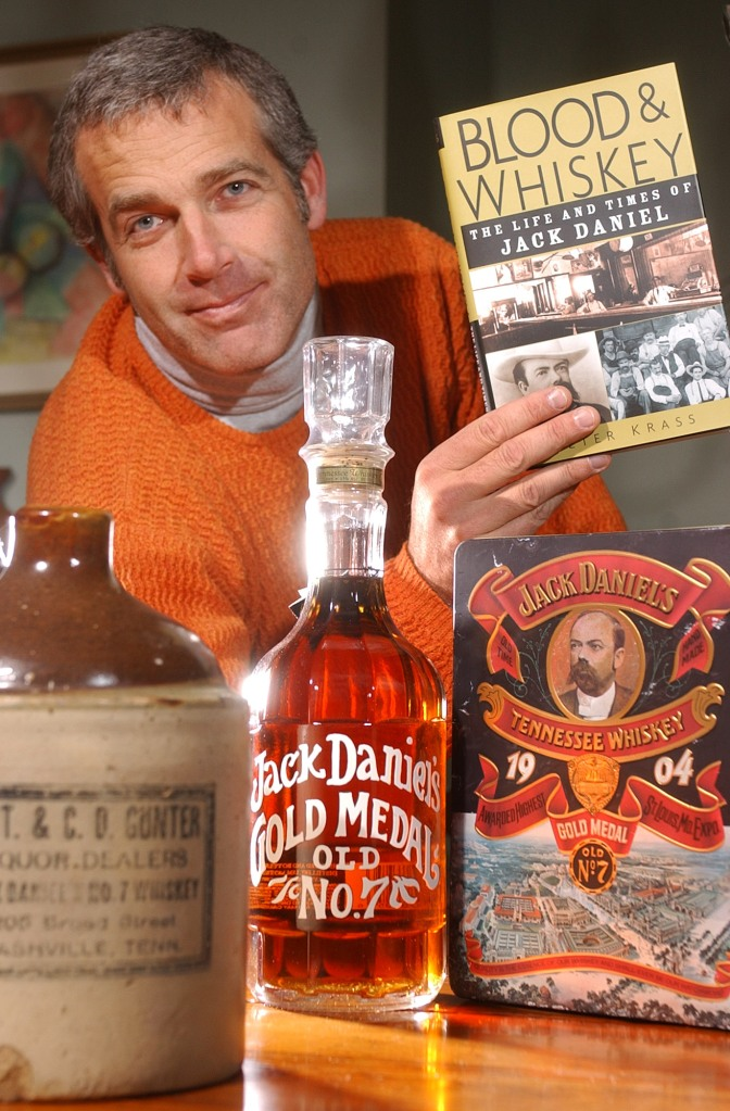 Jack Daniel's biographer Peter Krass poses with his book and some artifacts from the distillery