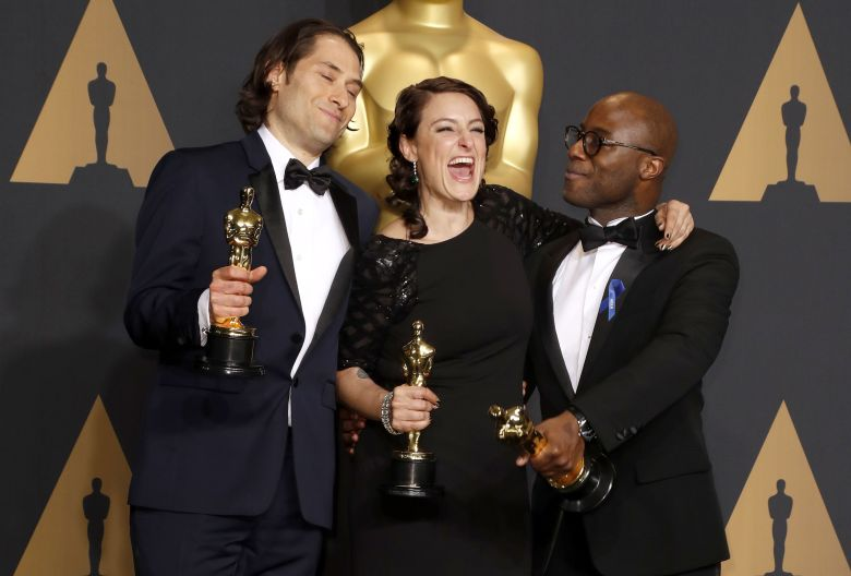 (L-R) Jeremy Kleiner, Adele Romanski, and director Barry Jenkins, hold the Oscar for Best Picture for 'Moonlight' in the press room during the 89th annual Academy Awards ceremony at the Dolby Theatre in Hollywood, California, USA, 26 February 2017. The Oscars are presented for outstanding individual or collective efforts in 24 categories in filmmaking.Press Room - 89th Academy Awards, Hollywood, USA - 28 Feb 2016