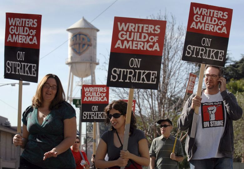 Writers Guild of America Members Carry Picket Signs in Front of Warner Bros Studios in Burbank California Usa On 14 January 2008 While the Strike is Prolonged Due to Lack of Negotiations Warner Bros Has Announced It May Lay Off As Many As 1 000 Employees As a Result of the Work StoppageUsa Cinema Writers Guild Strike - Jan 2008