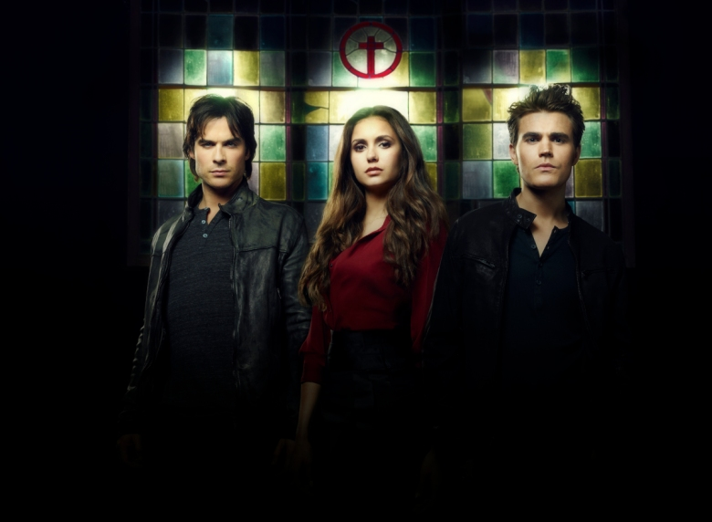 The Vampire Diaries -- Pictured (L-R): Ian Somerhalder as Damon, Nina Dobrev as Elena, and Paul Wesley as Stefan -- Image Number: VD4_StainedGlass_3327ri.jpg -- Photo: Justin Stephens/The CW -- © 2013 The CW Network, LLC. All rights reserved.