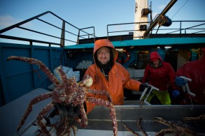 Summer Bay engineer, Tim Boles sorts large crab with deckhand, Kyle Craig.