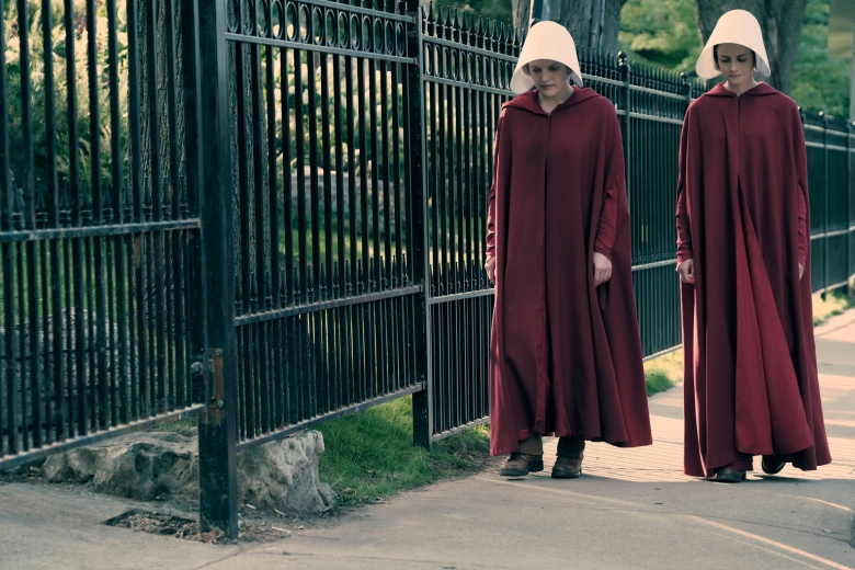 "The Handmaid's Tale -- ""Offred"" -- Episode 101 -- Offred, one the few fertile women known as Handmaids in the oppressive Republic of Gilead, struggles to survive as a reproductive surrogate for a powerful Commander and his resentful wife. Offred (Elisabeth Moss) and Ofglen (Alexis Bledel), shown. (Photo by: George Kraychyk/Hulu)"