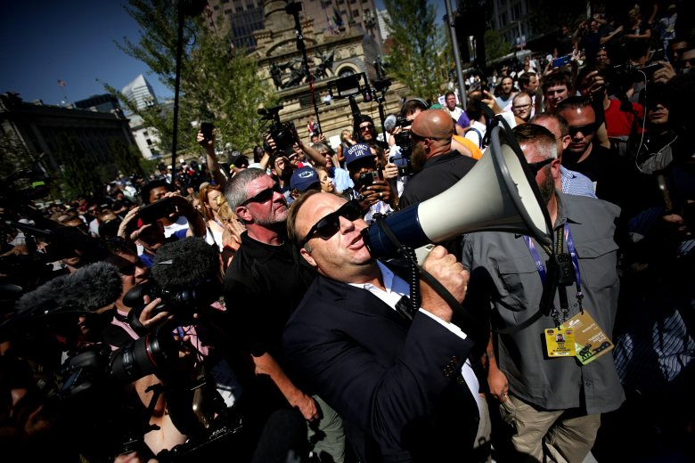 Us Radio Host Alex Jones (c) Uses a Megaphone to Speak to Crowds Near the Quicken Loans Arena the Venue For the 2016 Republican National Convention in Cleveland Ohio Usa 19 July 2016 the Four-day Convention is Expected to End with Donald Trump Formally Accepting the Nomination of the Republican Party As Their Presidential Candidate in the 2016 Election United States ClevelandUsa Republican National Convention - Jul 2016
