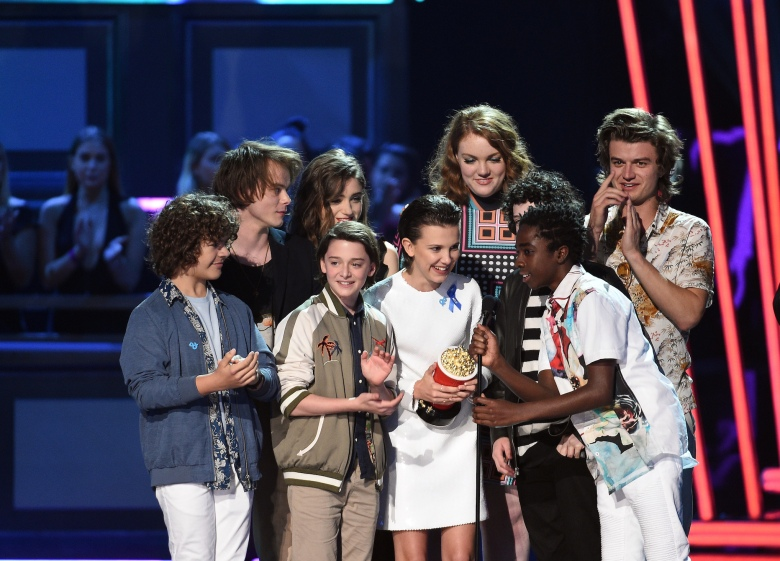 LOS ANGELES, CA - MAY 07: (L-R) Actors Gaten Matarazzo, Charlie Heaton, Noah Schnapp, Natalia Dyer, Shannon Purser, Millie Bobby Brown, Finn Wolfhard, Joe Keery, and Caleb McLaughlin accept the award for Show of the Year onstage during the 2017 MTV Movie And TV Awards at The Shrine Auditorium on May 7, 2017 in Los Angeles, California. (Photo by Kevork Djansezian/Getty Images)