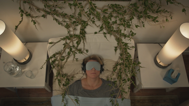 BALTIMORE, MD.- Kathy Conneally in bed with vines. (Photo credit: Asylum Entertainment)