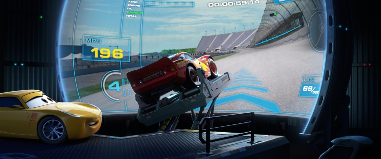 "SIMULATED SPEED — Tech-savvy trainer Cruz Ramirez (voice of Cristela Alonzo) is armed with cutting-edge tools—like a racing simulator—to help turn racers-in-training into champions. But Lightning McQueen (voice of Owen Wilson) isn't a fan of Cruz's high-tech techniques and decides instead to return to his roots—bringing his skeptical trainer along for the ride. Disney•Pixar's ""Cars 3"" opens in U.S. theaters on June 16, 2017. ©2017 Disney•Pixar. All Rights Reserved."
