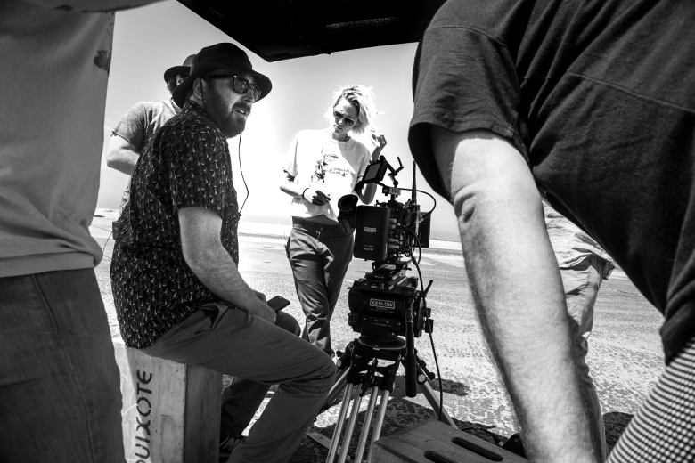 "Kristen Stewart and DP John Guleseria on the set of ""Come Swim"""