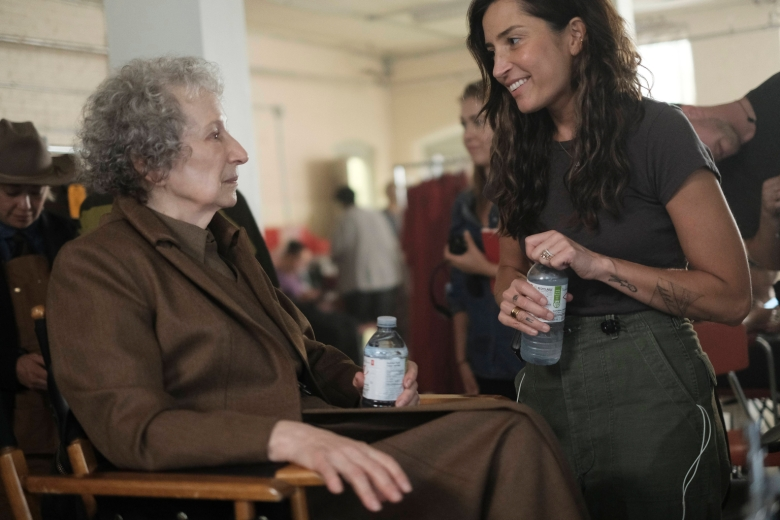 "The Handmaid's Tale  -- ""Offred"" -- Episode 101 -- Offred, one the few fertile women known as Handmaids in the oppressive Republic of Gilead, struggles to survive as a reproductive surrogate for a powerful Commander and his resentful wife. Behind the scenes with Margaret Atwood and Reed Morano, shown. (Photo by: George Kraychyk/Hulu)"