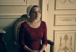 "The Handmaid's Tale  -- ""Late"" Episode 103 --  Offred visits Janine's baby with Serena Joy and remembers the early days of the revolution before Gilead. Ofglen faces a difficult challenge. Offred (Elisabeth Moss), shown. (Photo by: George Kraychyk/Hulu)"
