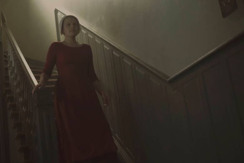 """The Handmaid's Tale -- """"A Woman's Place"""" -- Episode 106 -- A Mexican Ambassador visiting Gilead questions Offred about her life as a Handmaid. Serena Joy reflects on her marriage and the role she once played in Gilead's inception. Offred (Elisabeth Moss), shown. (Photo by: George Kraychyk/Hulu)"""