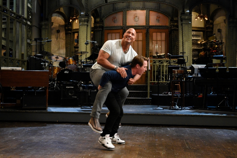 "SATURDAY NIGHT LIVE -- ""Dwayne Johnson"" Episode 1725 -- Pictured: (l-r) Dwayne Johnson with Beck Bennett in Studio 8H on May 16, 2017 -- (Photo by: Rosalind O'Connor/NBC)"