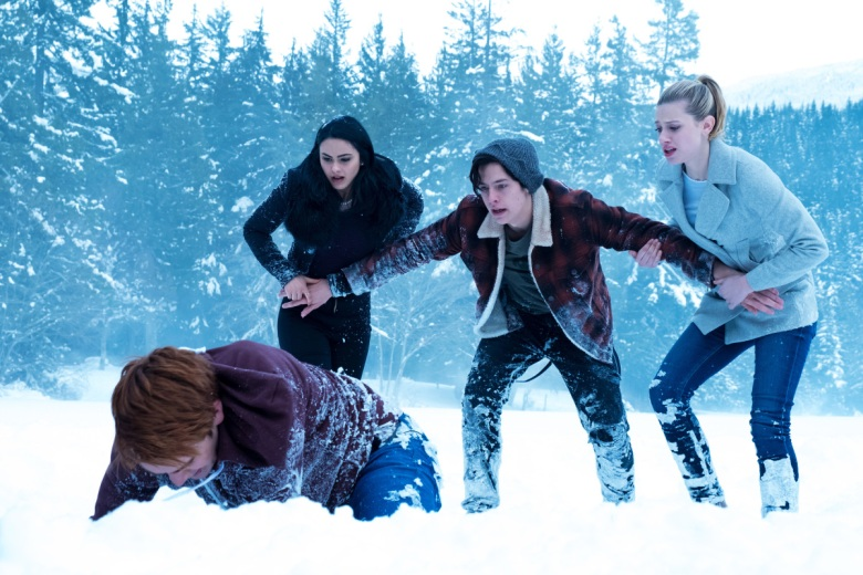 "Riverdale -- ""Chapter Thirteen: The Sweet Hereafter"" -- Image Number: RVD113a_0172.jpg -- Pictured (L-R): KJ Apa as Archie Andrews, Camila Mendes as Veronica Lodge, Cole Sprouse as Jughead Jones, and Lili Reinhart as Betty Cooper"