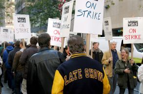 A Writer Wearing a Jacket From the Show 'Late Night with David Letterman' Walks with a Picket Sign During the Start of a Strike by Television and Film Writers in Front of Nbc Studios at Rockefeller Center in New York New York Usa On 05 November 2007 Writers Who Are Striking For the First Time Since 1988 Are Demanding a Larger Share of Dvd Profits and Revenue From the Distribution of Films and Tv Shows Over the InternetUsa Writers Strike - Nov 2007