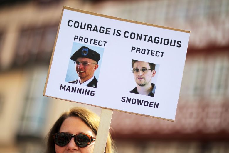 GERMANY OUTMandatory Credit: Photo by Fredrik Von Erichsen/Epa/REX/Shutterstock (8228970a)A Woman Holds a Banner with the Portraits of Us Whistleblowers Chelsea Manning (l) and Edward Snowden (r) During the Traditional Easter March of the German Peace Movement in Frankfurt Main Germany 21 April 2014 This Year's Protest is Aimed to an End of German Arms Exports and More Peace in the World Germany Frankfurt/mainGermany Traditions Easter March - Apr 2014