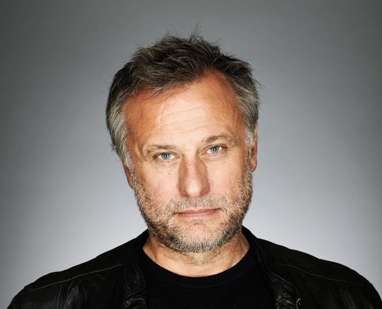 Michael Nyqvist by Daniel Bergeron. Indiewire 2015. No PR/No Release on file.