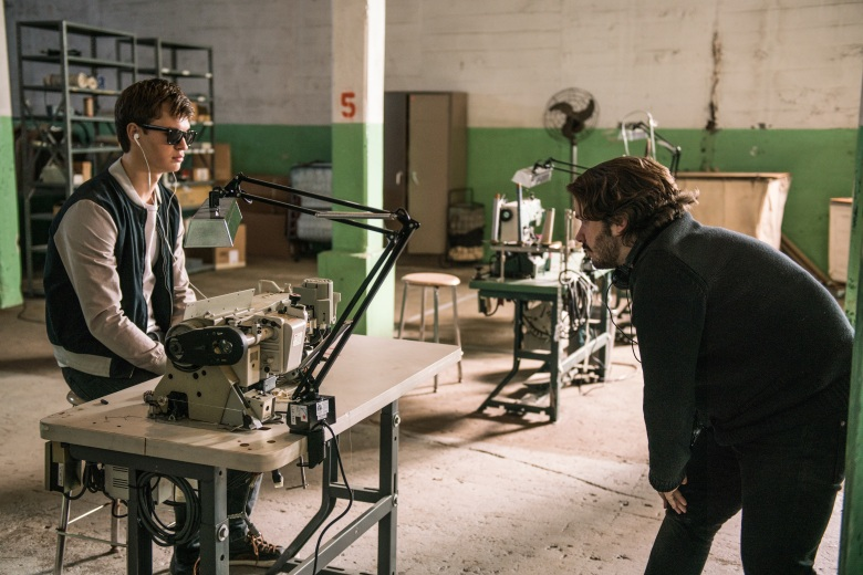 "Ansel Elgort and director Edgar Wright in ""Doc's loft"" on the set of TriStar Pictures' BABY DRIVER."