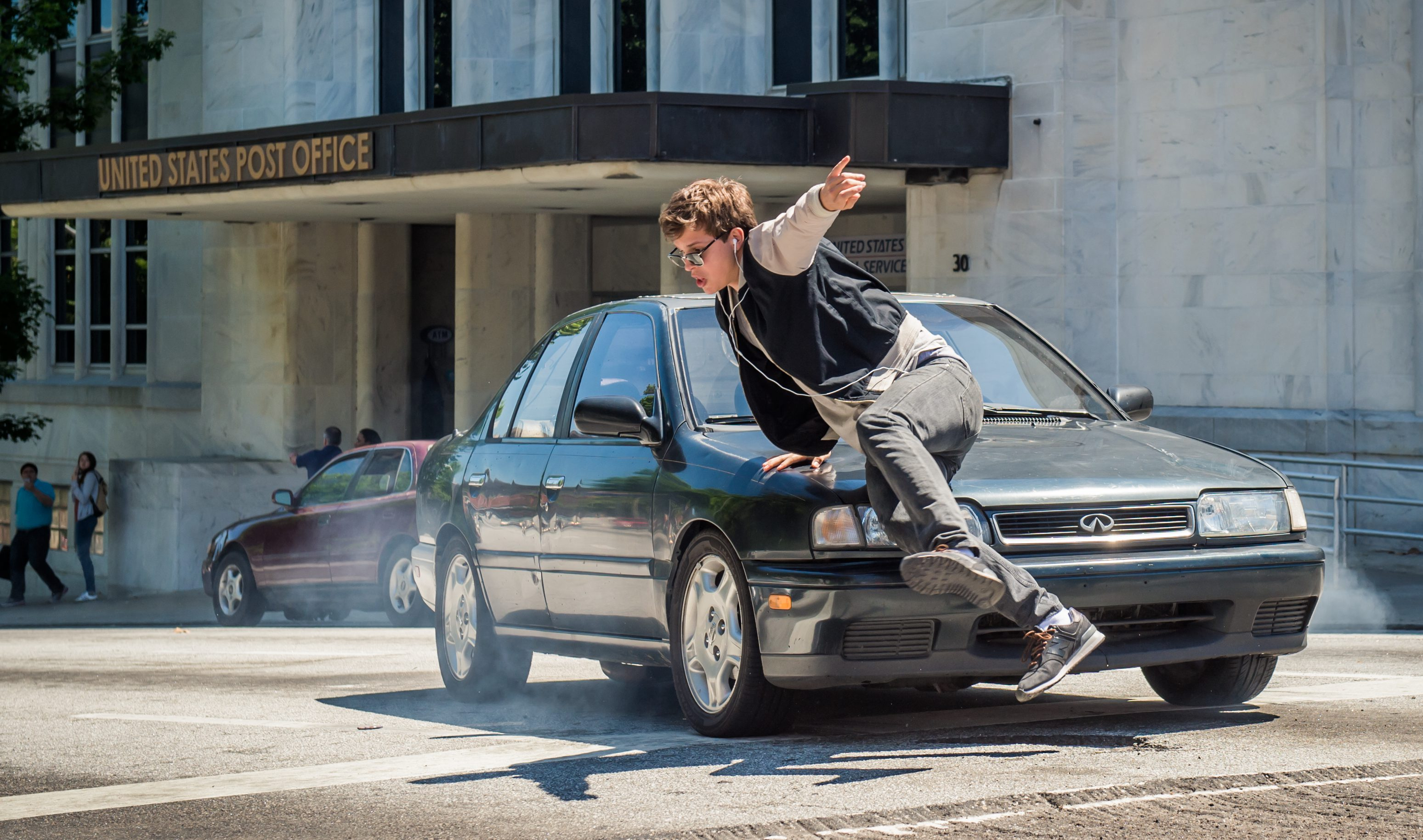 Baby (ANSEL ELGORT) is chased by the cops in TriStar Pictures' BABY DRIVER.