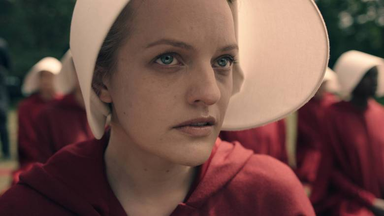 """THE HANDMAID'S TALE -- """"Offred"""" - Episode 101 - Offred, one the few fertile women known as Handmaids in the oppressive Republic of Gilead, struggles to survive as a reproductive surrogate for a powerful Commander and his resentful wife. Offred (Elisabeth Moss), shown. (Photo by: Take Five/Hulu)"""