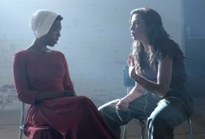 "The Handmaid's Tale  -- ""Offred"" -- Episode 101 -- Offred, one the few fertile women known as Handmaids in the oppressive Republic of Gilead, struggles to survive as a reproductive surrogate for a powerful Commander and his resentful wife. Behind the scenes with Moira (Samira Wiley) and Reed Morano, shown. (Photo by: George Kraychyk/Hulu)"