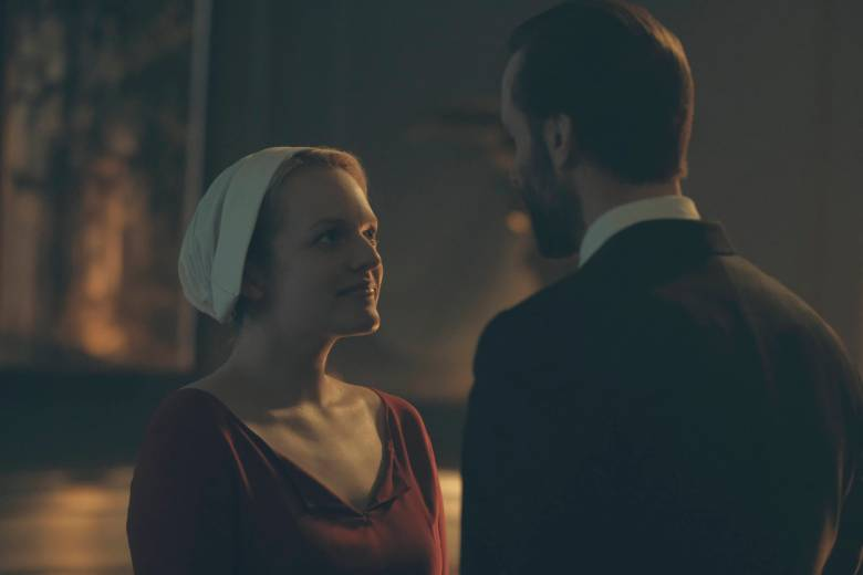"The Handmaid's Tale -- ""The Bridge"" -- Episode 109 -- Offred embarks on a dangerous mission for the resistance. Janine moves to a new posting. Serena Joy suspects the Commander's infidelity. Offred (Elisabeth Moss) and Commander Waterford (Joseph Fiennes), shown. (Photo by: George Kraychyk/Hulu)"